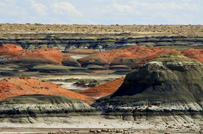 Bisti Badlands New Mexico colorful black and red pyramids