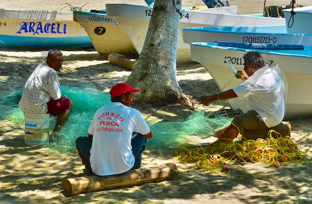Fishermen mending nets in Zihuatanejo