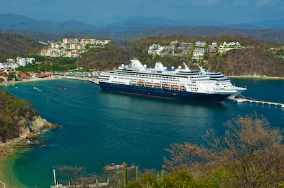 Cruise ships Regatta and Amsterdam dwarf surrounding Santa Cruz Bay in Huatulco (from our sailing blog)