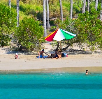 Tropical beach play in Paraiso Mexico cove with boat