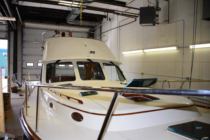 Deck being attached to hull at Hinckley Yachts in Trenton Maine