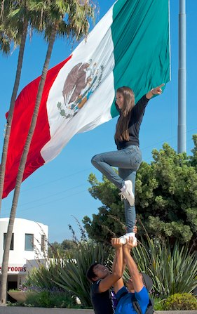 Cheerleaders Practicing with Mexican Flag