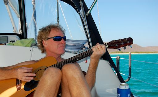 playing guitar on a boat