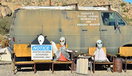 Aliens sitting in chairs near San Diego
