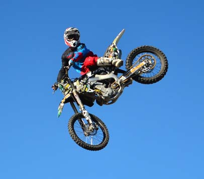 Leaping motocross riders