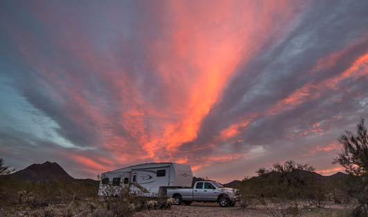 Fifth wheel RV at sunrise
