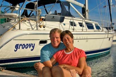 Mark and Emily Fagan with sailboat Groovy