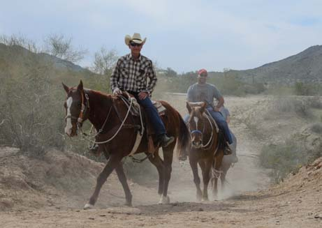 Horseback riders on the dusty trail