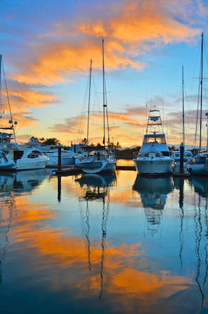 Sunset over sailboats at Paradise Village Marina