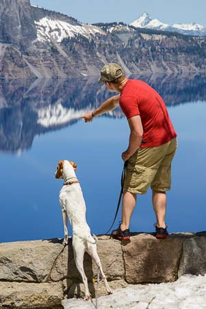 Dog and owner check out Crater Lake