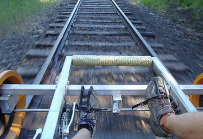 Two feet pedaling the rail riding bike