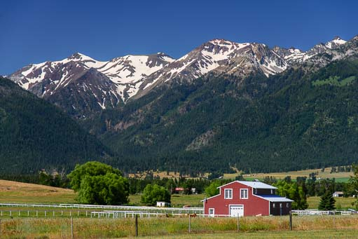 Snow-capped Wallowa mountains and red barn