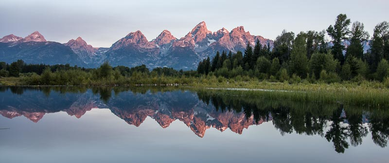 Perfect reflections of the Teton Mountains at Shwabacher Landing