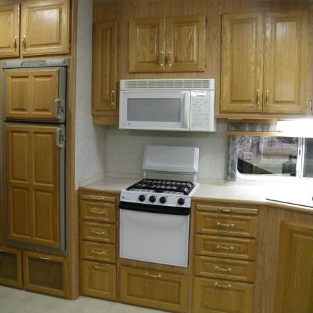 Kitchen in a 2002 33' Custom Automate 5th Wheel RV