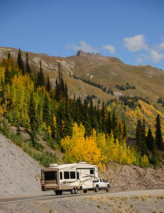 A fifth wheel RV starts over Red Mountain Pass in Colorado