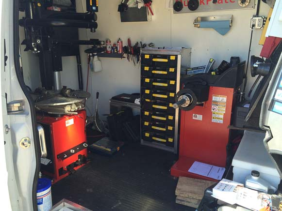 Interior of a mobile mechanic van providing tire replacement service