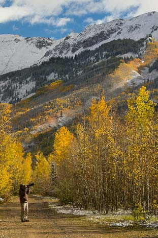 Photographer taking photos in Colorado fall foliage