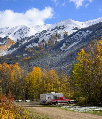 Travel trailer in snowy Colorado mountains