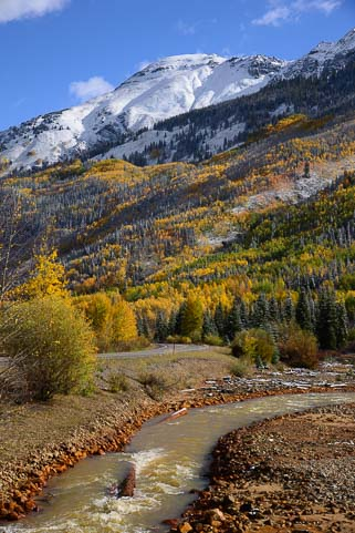 Colorado Mountain stream with snow in autumn