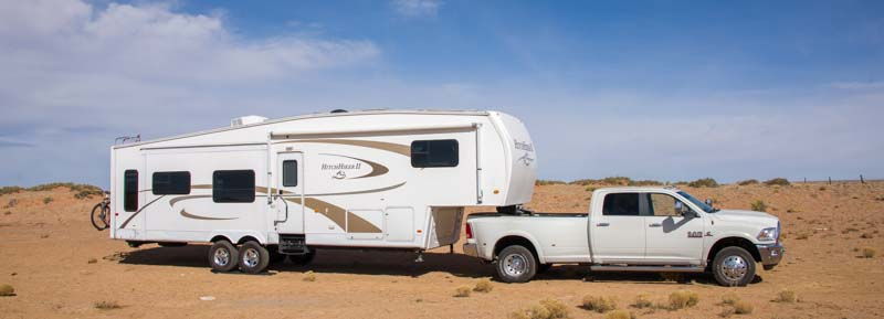 Dodge Ram 3500 Dually Truck towing a 36' NuWa Hitchhiker Fifth Wheel Trailer RV