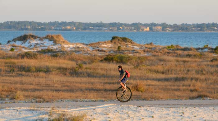 Unicycle commute to work in Florida beach