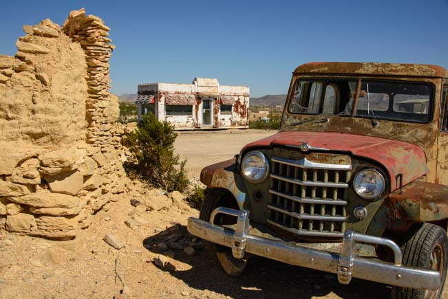 Rusty car and old building in Terlingua