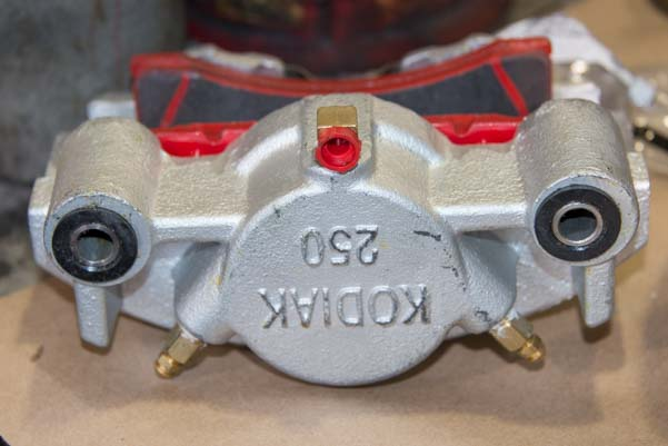 Kodiak disc brake caliper with brake shoes