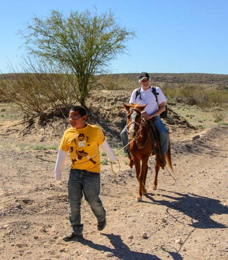 Riding a burro to Boquillas del Carmen Mexico near Big Bend National Park Texas