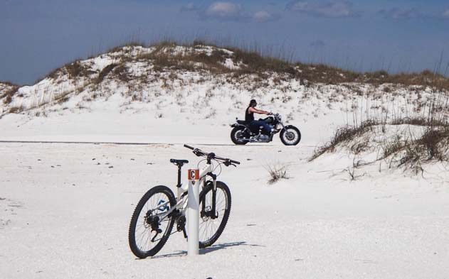 Bicycle on white sand Gulf Islands National Seashore Florida