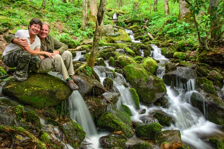 sitting by waterfall in smoky mountains north carolina