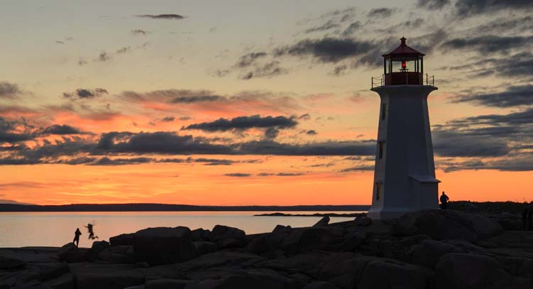 Sunset silhouettes Peggy's Cove Nova Scotia Canada