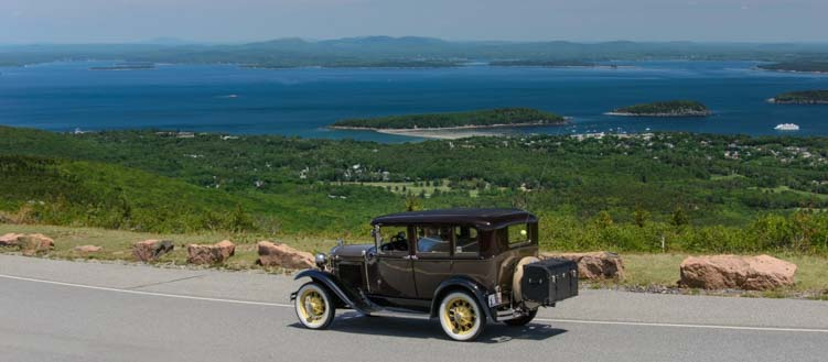 Ford Model A car drives down Cadillac Mountain Acadia National Park Maine