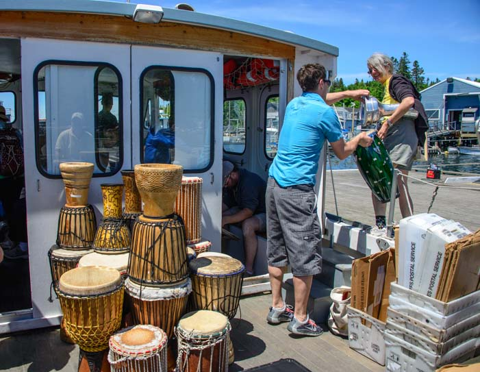 Bongo drums loaded onto Double B mail boat on Cranberry Island