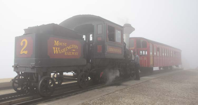 Fog shrouds the Cog Rail train at the top of Mt Washington New Hampshire