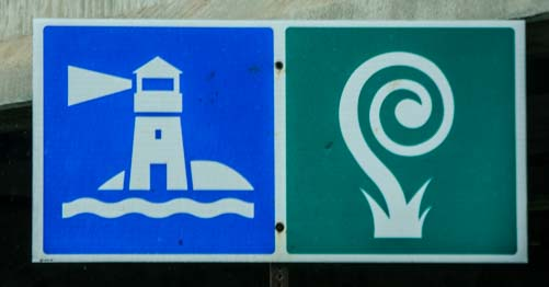 Lighthouse and snail roadsign_