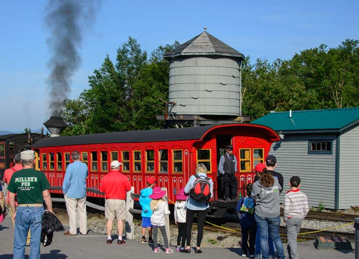 The Cog Railway train car arrives at the station