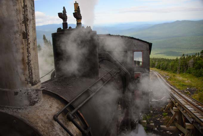 Cog Railway Train chugs up Mt Washington New Hampshire