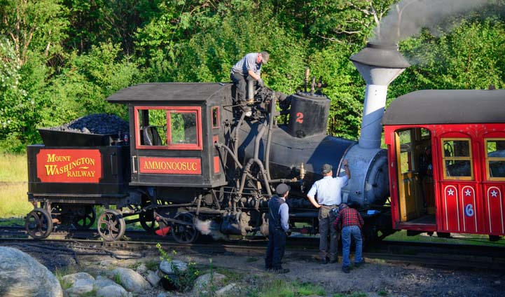 The Cog Railway crew inspects the coal fired steam engine train
