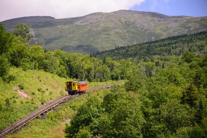 Mt Washington Cog Railway train climbs the mountain