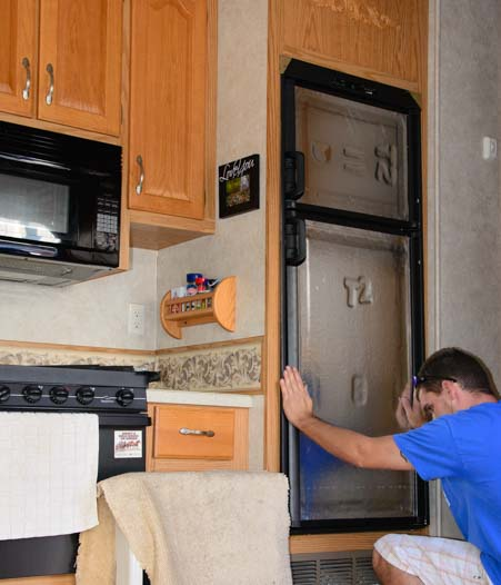RV warranty repair New RV refrigerator installed in fifth wheel trailer