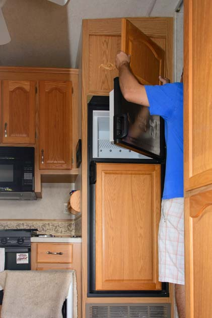 Under warranty Oak panel installed on RV refrigerator door