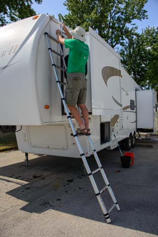 Telescoping ladder on an RV