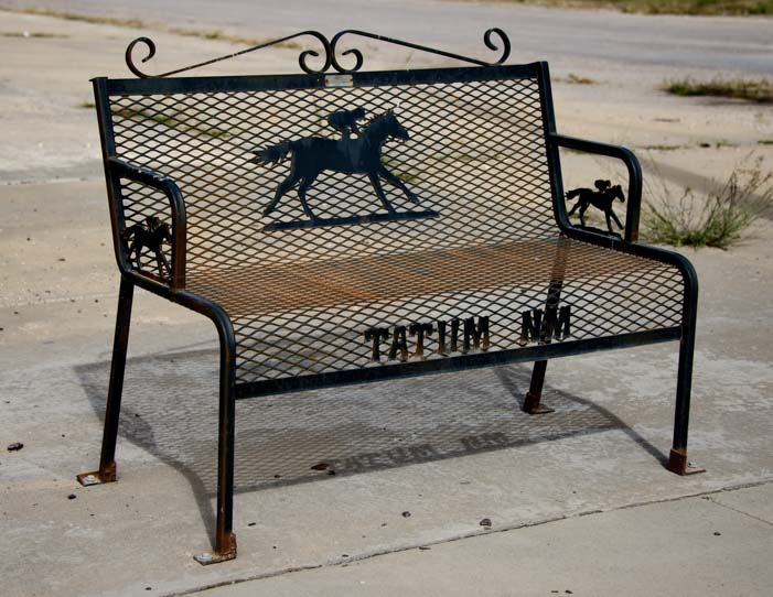 Metal art on park bench Tatum New Mexico