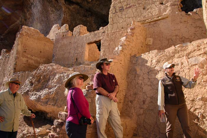 Volunteer National Park Service Guide leads tour Tonto National Monument