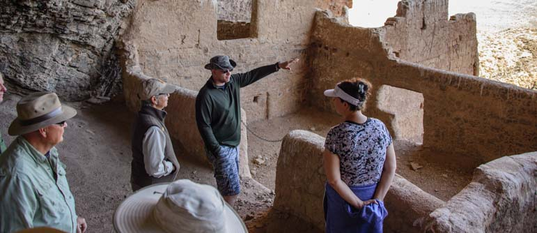 Tour group upper cliff dwellings Tonto National Monument Arizona