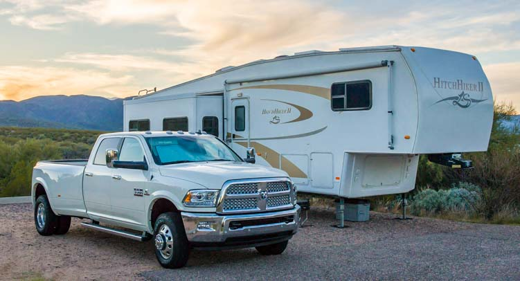 2016 Ram 3500 dually diesel truck with fifth wheel trailer at campground