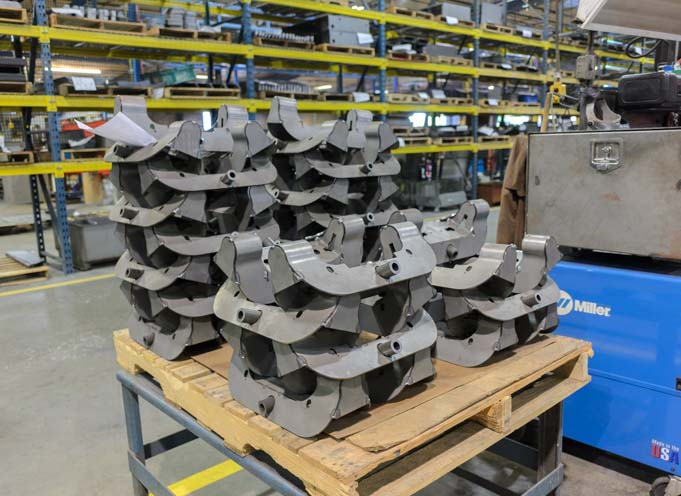 B&W Fifth wheel hitch heads stacked up at factory