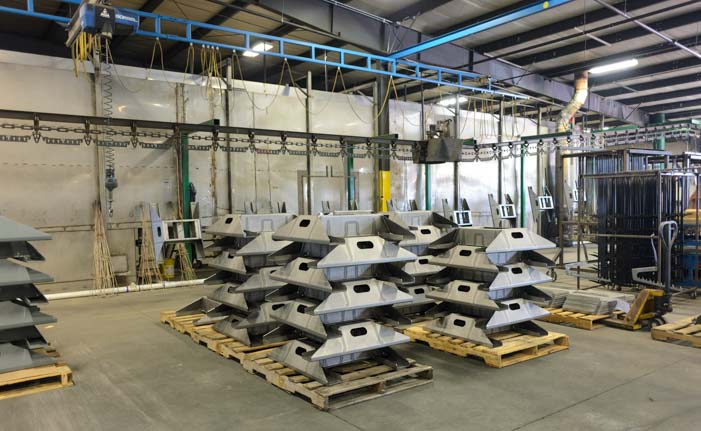 B&W Fifth wheel hitch bases stacked up at factory