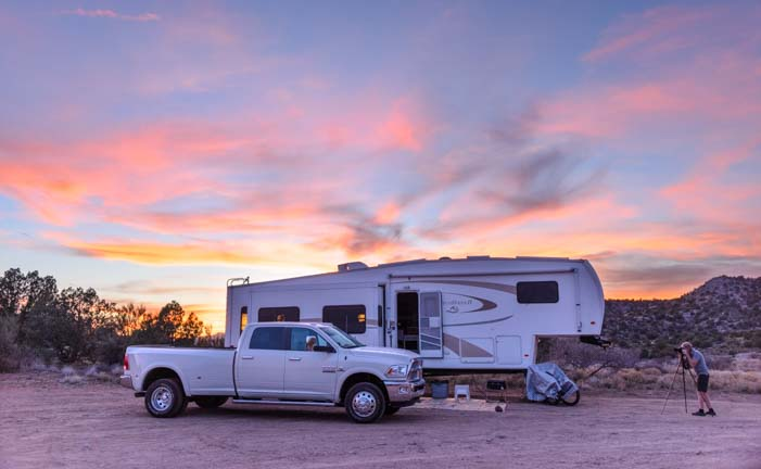 Truck and fifth wheel trailer RV at sunset