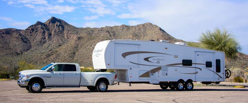 Dodge Ram 3500 dually truck with B&W Companion OEM Fifth Wheel Hitch in the bed